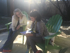 Carmen working with student Eliza Kinkz at Austin's Writing Barn.