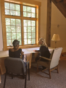 Carmen Oliver (right) working with an author at our Retreat Center.