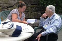 Tracie Lane of Front Royal Virginia and editor Peter Jacobi discuss suggestions for her manuscript.