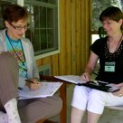 Kim Griswell works with one of our conferees.
