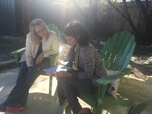 Carmen working with student Eliza Kinkz at Austin's Writing Barn.