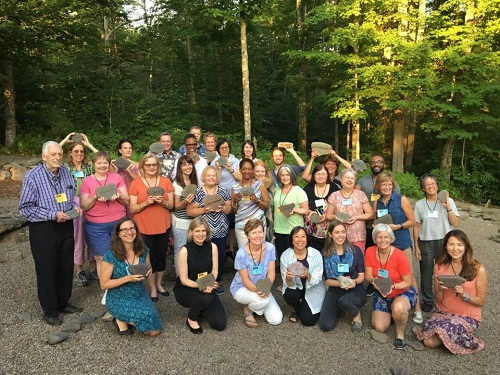 "Faculty and attendees to the first ""Master Class in Nonfiction for Children and Young Adults"" gather in the Word Garden at the Highlights Foundation Retreat Center in Boyds Mill, PA."