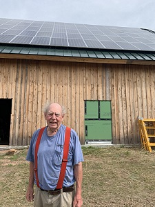 Kent Brown in front of the new solar array.